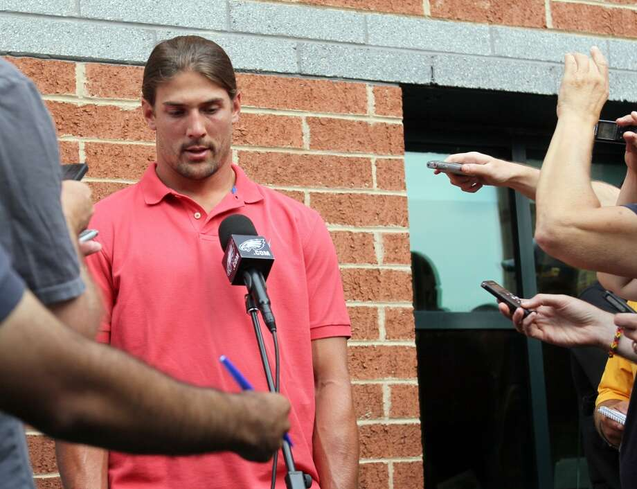 "Philadelphia Eagles wide receiver Riley Cooper meets with the media at NFL football training camp on Wednesday, July 31, 2013, in Philadelphia. Cooper has been fined by the team for making a racial slur at a Kenny Chesney concert that was caught on video, leading him to say he's ""ashamed and disgusted"" with himself. Cowboys safety Will Allen said he was ""extremely offended"" by Cooper's racial slur and expects the Eagles wide receiver to be targeted during games. Here's a look at Cooper's last encounter with the Cowboys. (AP Photo / Philadelphia Daily News, Yong Kim) Photo: Yong Kim, Associated Press"