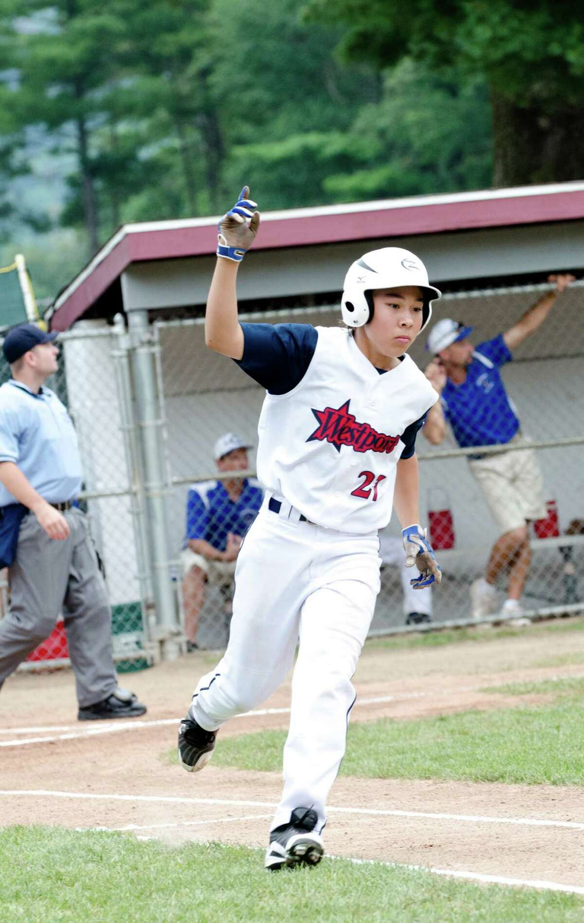 Westport's Chad Knight puts his hand in the air as he takes a victory lap around the bases during the 12-year-old Little League baseball state finals against Coginchaug at Southington South Little League at Recreation Park on Maxwell Noble Drive in Plantsville on Sunday, July 28, 2013.