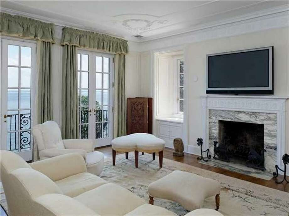 Here you can see one of nine fireplaces inside Hollywood producer Bob Weinstein's 12,788 square foot home on Byram Shore, which hit the market last month for $32 million. Photo: Via Trulia.com