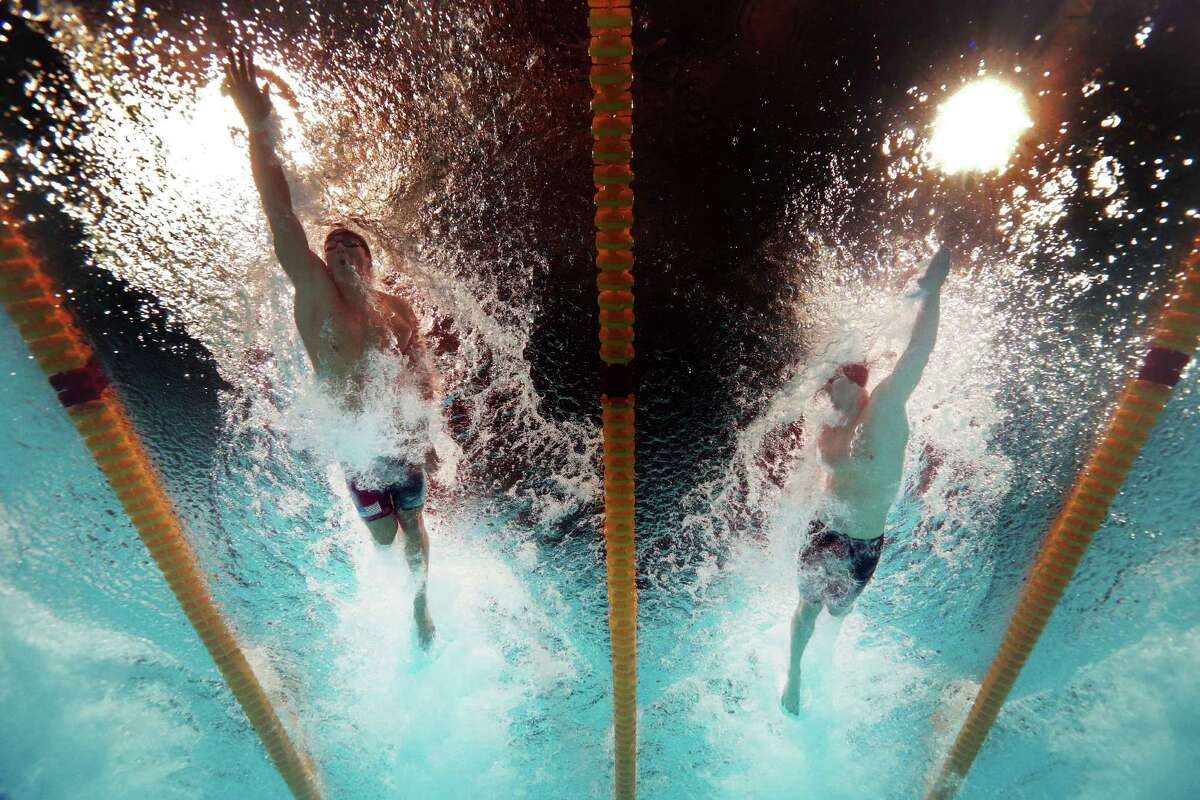Nathan Adrian (L) and James Feigen of the USA compete during the Swimming Men's Freestyle 100m Final on day thirteen of the 15th FINA World Championships at Palau Sant Jordi on August 1, 2013 in Barcelona, Spain.