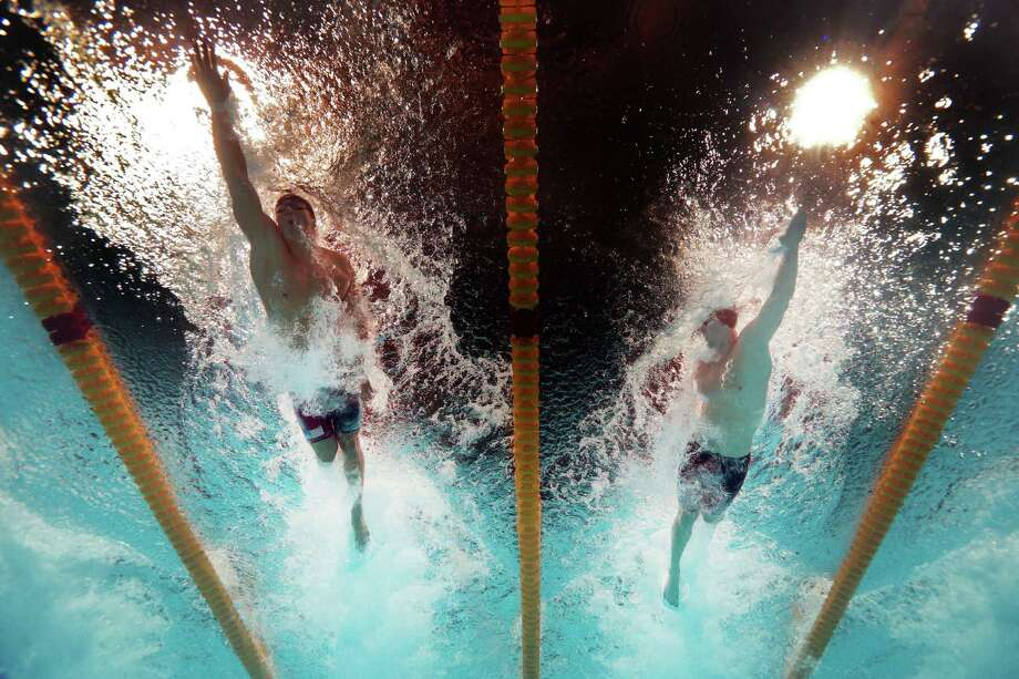 Nathan Adrian (L) and James Feigen of the USA compete during the Swimming Men's Freestyle 100m Final on day thirteen of the 15th FINA World Championships at Palau Sant Jordi on August 1, 2013 in Barcelona, Spain. Photo: Quinn Rooney, Getty Images / 2013 Getty Images