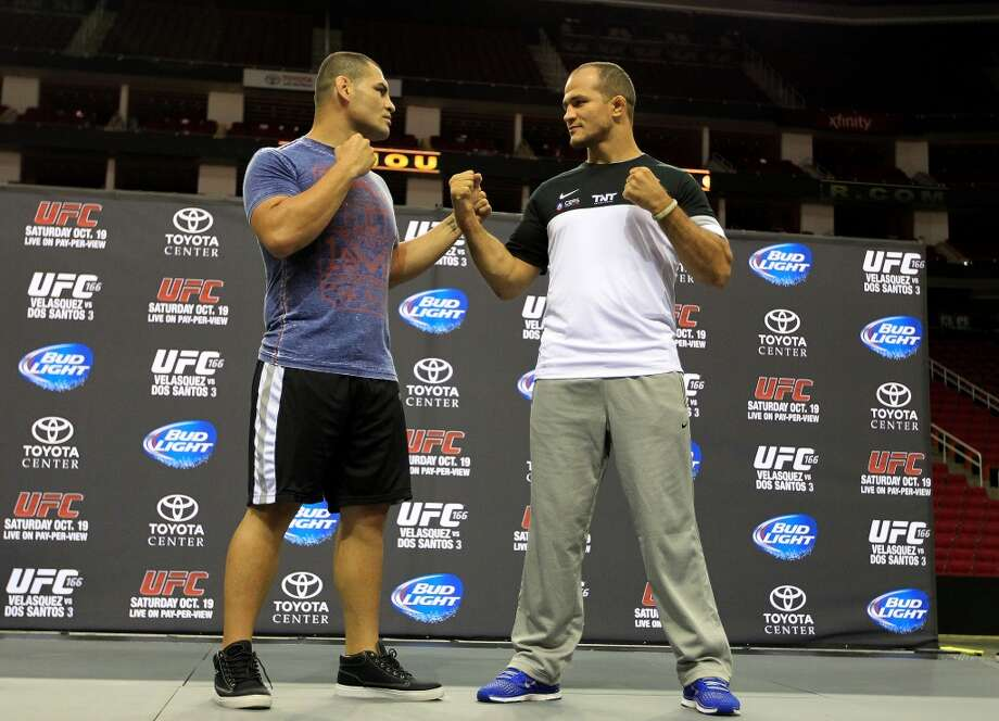 Cain Velasquez, left, faces off against Junior dos Santos, right, during an open workout with the UFC heavyweight champion Velasquez and former champion dos Santos at Toyota Center, Thursday, Aug. 1, 2013, in Houston. It was free and open to the public as they talked about their upcoming pay-per-view fight which will take place Saturday, October 19 at Toyota Center.  ( Karen Warren / Houston Chronicle ) Photo: Karen Warren, Houston Chronicle
