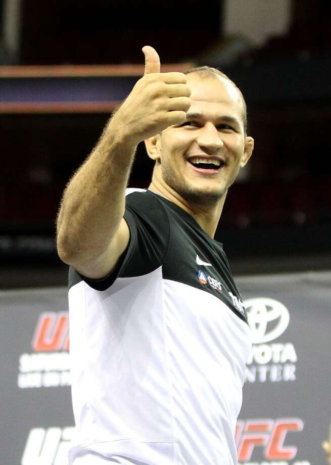 Junior dos Santos gives a thumbs up during an open workout with UFC heavyweight champion Cain Velasquez and former champion Junior dos Santos at Toyota Center, Thursday, Aug. 1, 2013, in Houston. It was free and open to the public as they talked about their upcoming pay-per-view fight which will take place Saturday, October 19 at Toyota Center.  ( Karen Warren / Houston Chronicle ) Photo: Karen Warren, Houston Chronicle