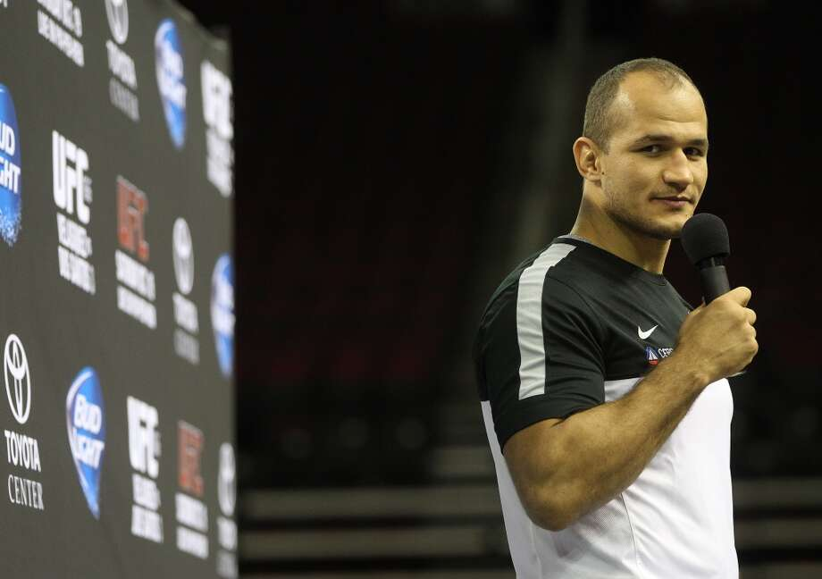Junior dos Santos talks to the fans during an open workout with UFC heavyweight champion Cain Velasquez and former champion Junior dos Santos at Toyota Center, Thursday, Aug. 1, 2013, in Houston. It was free and open to the public as they talked about their upcoming pay-per-view fight which will take place Saturday, October 19 at Toyota Center.  ( Karen Warren / Houston Chronicle ) Photo: Karen Warren, Houston Chronicle
