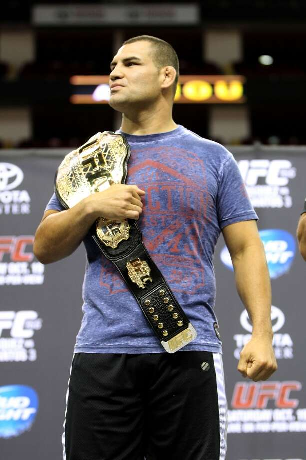 Cain Velasquez wears his belt during an open workout with UFC heavyweight champion Cain Velasquez and former champion Junior dos Santos at Toyota Center, Thursday, Aug. 1, 2013, in Houston. It was free and open to the public as they talked about their upcoming pay-per-view fight which will take place Saturday, October 19 at Toyota Center.  ( Karen Warren / Houston Chronicle ) Photo: Karen Warren, Houston Chronicle