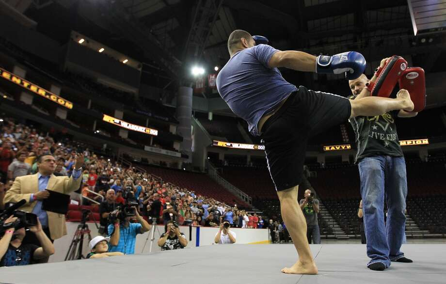 Cain Velasquez spars with Bob Cook, one of his trainers,  during an open workout with UFC heavyweight champion Cain Velasquez and former champion Junior dos Santos at Toyota Center, Thursday, Aug. 1, 2013, in Houston. It was free and open to the public as they talked about their upcoming pay-per-view fight which will take place Saturday, October 19 at Toyota Center.  ( Karen Warren / Houston Chronicle ) Photo: Karen Warren, Houston Chronicle