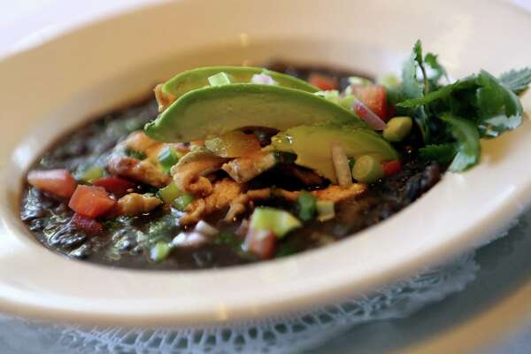 Frederick's Bistro's Country-Style Black Bean Soup with Cilantro Pesto can be served as a first course, or as the centerpiece of a casual meal.