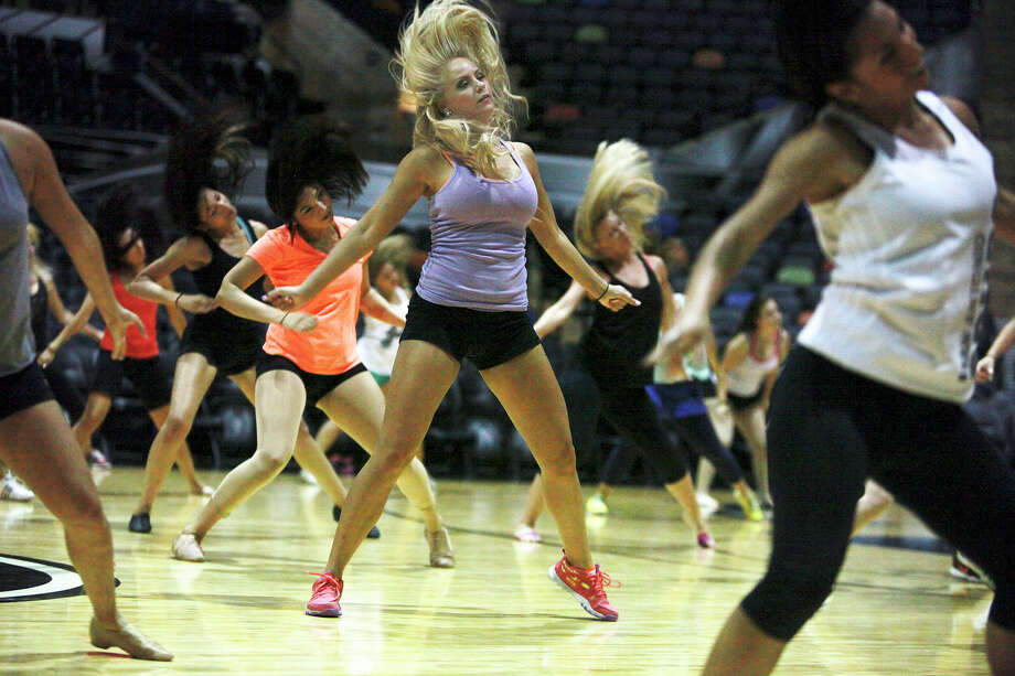 Women practice a routine during the Silver Dancers prep class at the AT&T Center on Wednesday, July 31, 2013. The formal auditions for the Silver Dancers is on August 10. Photo: Abbey Oldham, San Antonio Express-News / © San Antonio Express-News