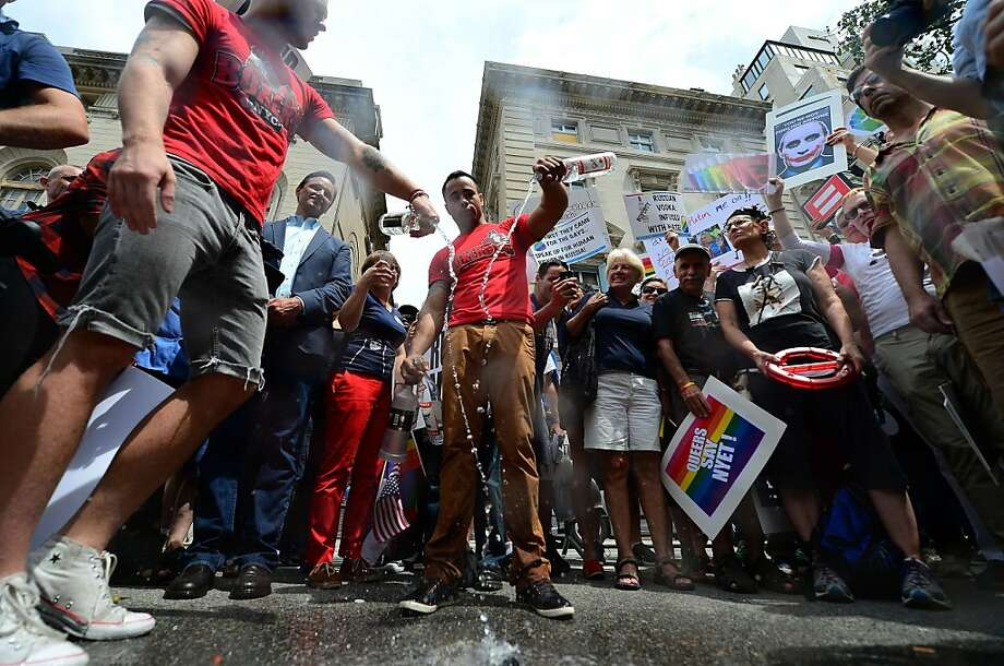 Protesters dump Russian vodka in a protest outside the Russian Consulate in New York on Wednesday as a protest of the antigay law. Photo: Emmanuel Dunand, AFP/Getty Images