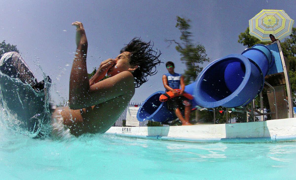Juan Urbiola, 12, cools off at Roosevelt Pool Thursday Aug. 1, 2013.