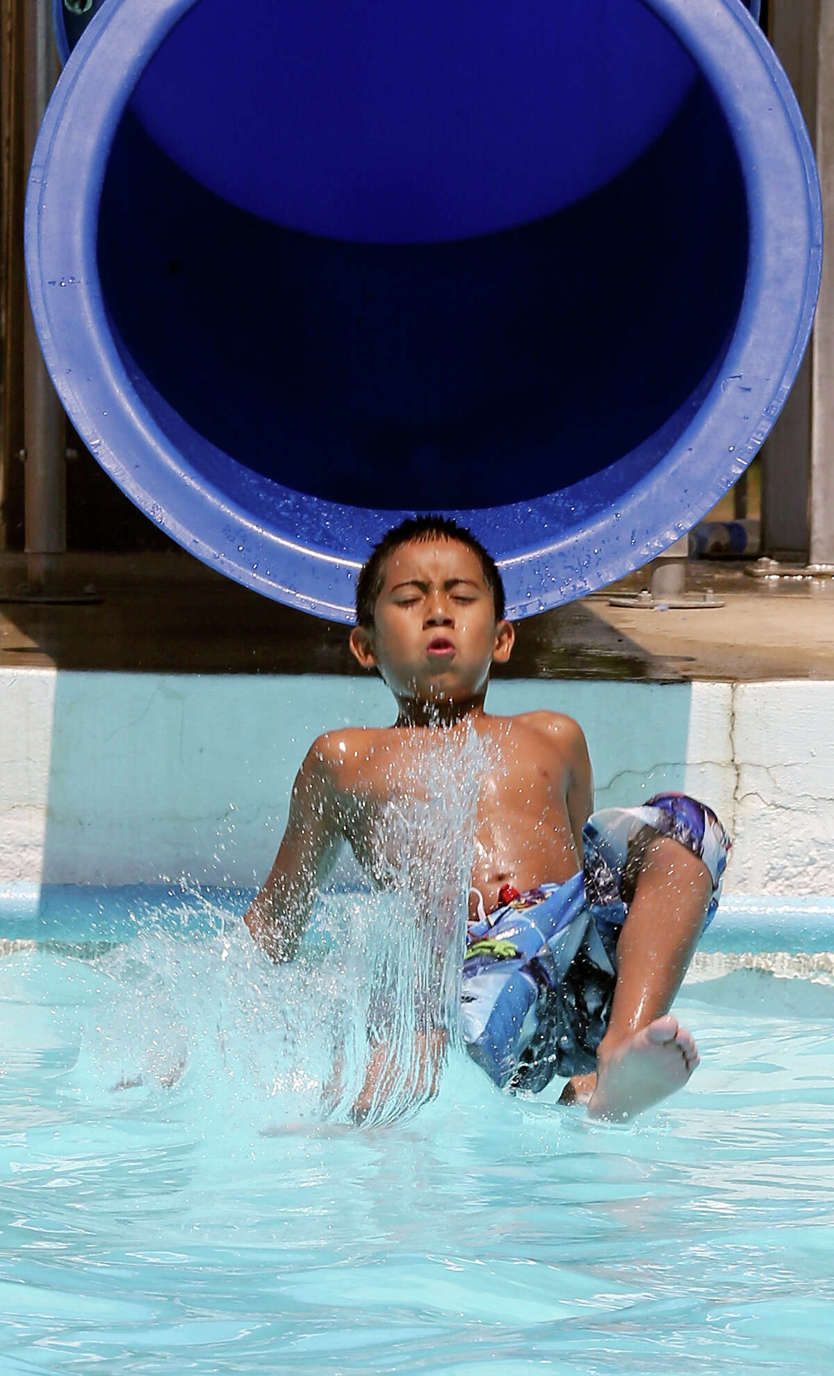 Michael Lopez, 8, cools off at Roosevelt Pool Thursday Aug. 1, 2013.