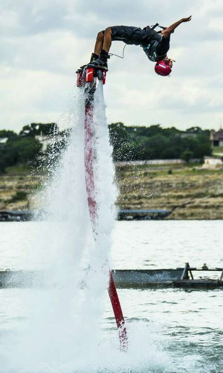 Damone Ripey of Aquafly Austin does a backflip on a flyboard on Lake Travis. While maneuvers like this one aren't for the beginner, the basics are easy to master. Photo: Joshua Trudell / For The Express-News