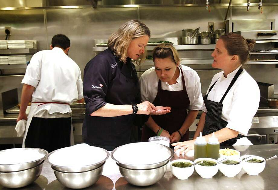 "Gayle Pirie of Foreign Cinema discusses ingredients with Lea Walker, center, also of Foreign Cinema, and April Bloomfield, right, of the Spotted Pig, at the ""Masters of Their Craft: Celebrating the Great Female Chefs and Sommeliers of San Francisco"" fundraising dinner in San Francisco, Calif., Sunday, July 28, 2013. Photo: Sarah Rice, Special To The Chronicle"