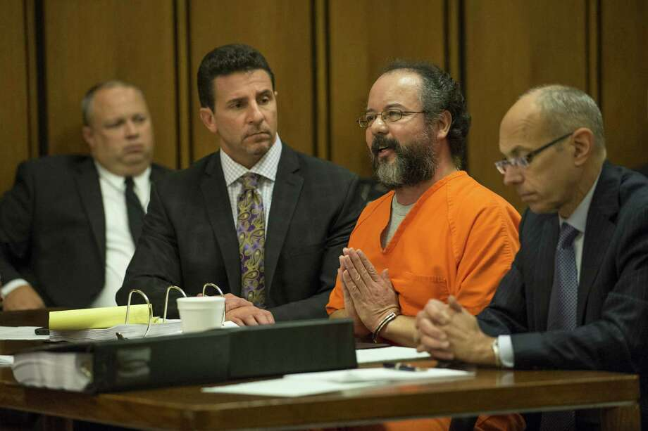 """I'm not a monster,"" Ariel Castro tells Judge Michael Russo at his sentencing Friday in Cleveland, Ohio. He got life without parole plus one thousand years for abducting three women between 2002 and 2004.  At right, Michelle Knight, one of the victims, tells Castro, ""You took 11 years of my life away and I have got it back."" Photo: Angelo Merendino, Stringer / 2013 Getty Images"