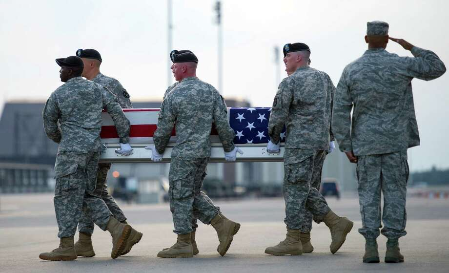 An Army carry team moves a transfer case containing the remains of Army Sgt. Anthony Maddox, 22, of Port Arthur, Texas, Saturday, July 27, 2013, at Dover Air Force Base, Del. According to the Department of Defense, Maddox died of a non-combat related incident that occurred in Andar, Afghanistan while he was supporting Operation Enduring Freedom. (AP Photo/Cliff Owen) Photo: AP, FRE / FR170079 AP