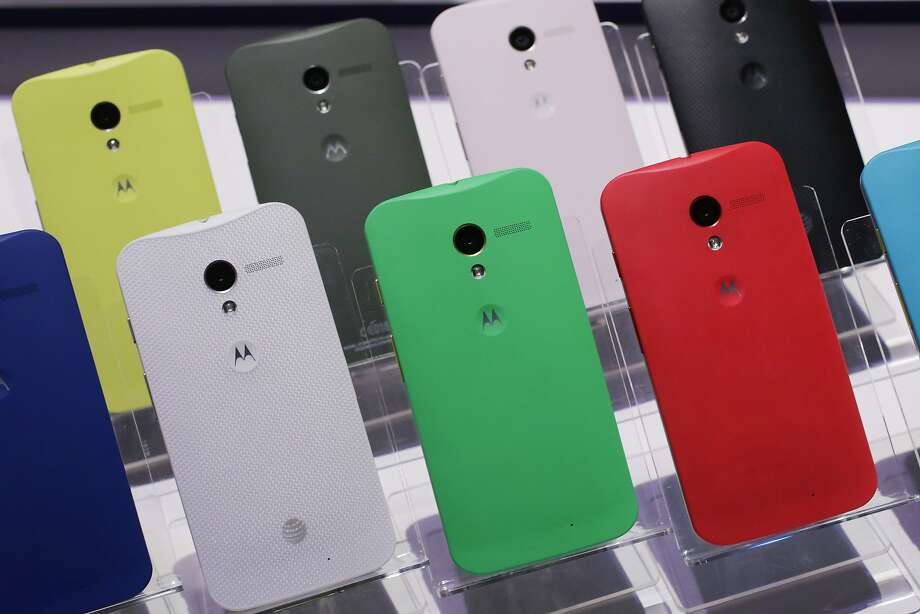 Motorola Moto X smartphones, using Google's Android software, are shown, Thursday, Aug. 1, 2013 at a press preview in New York. The back of the phone is available in 18 colors. (AP Photo/Mark Lennihan) Photo: Mark Lennihan, Associated Press