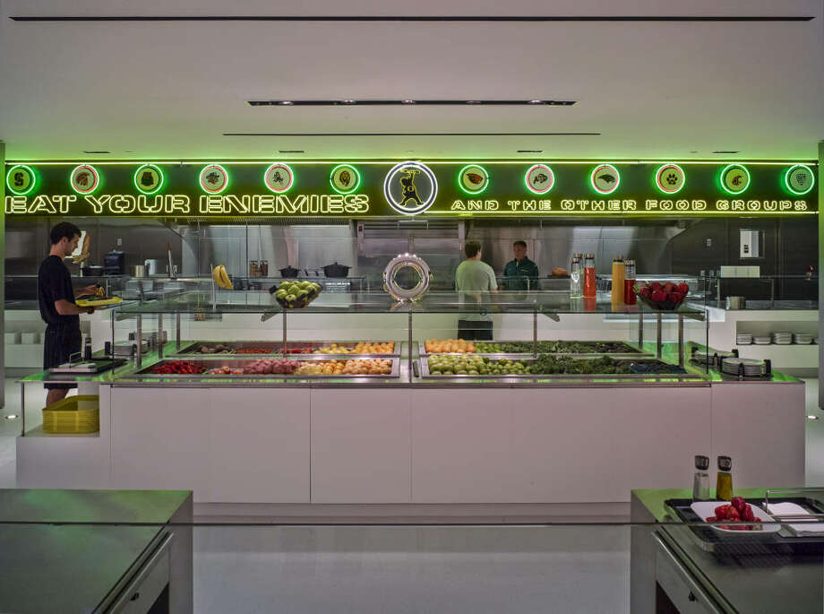 Here we are in the cafeteria, which boasts a neon sign that reads: ''Eat your enemies -- and the other food groups.''  Photo: Eric Evans, GoDucks.com