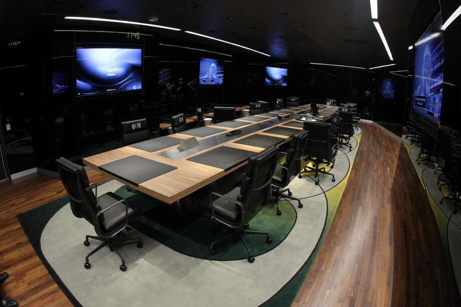 Dr. Strangelove would feel right at home in this nuclear war room football meeting room. Well, scratch that -- Dr. Strangelove wouldn't know what to do with six 80-inch HD televisions, black magnetic walls (that double as whiteboards) and plenty of other modern amenities.  Photo: Eric Evans, GoDucks.com