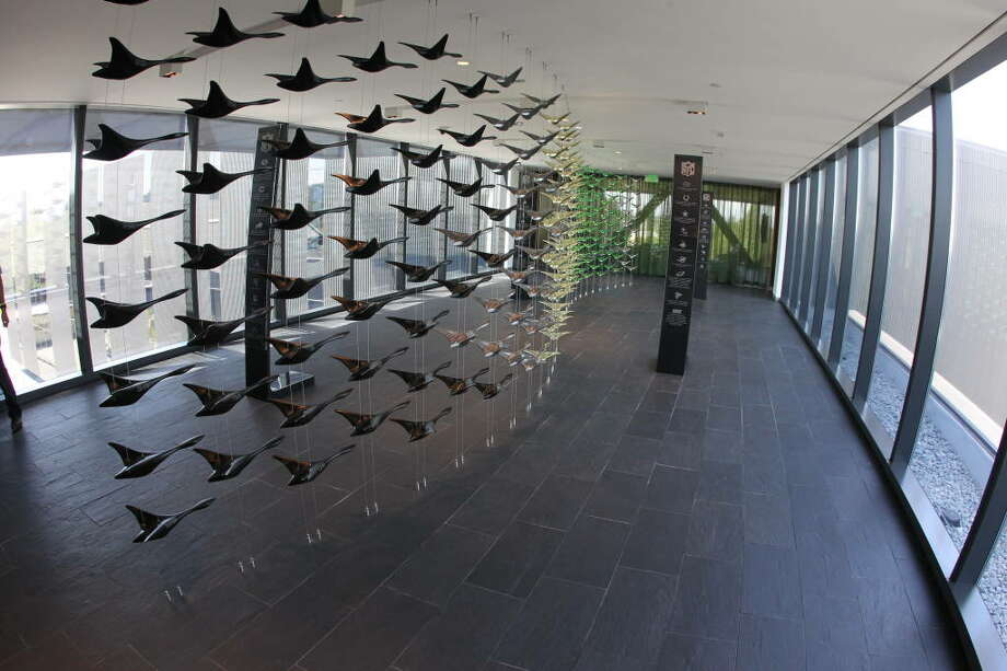 Connecting the complex's office wing with rest of the facility is this sixth-floor skybridge. The flying-ducks sculpture is more than just that -- each duck represents an Oregon player who was drafted into the NFL.  Photo: Eric Evans, GoDucks.com