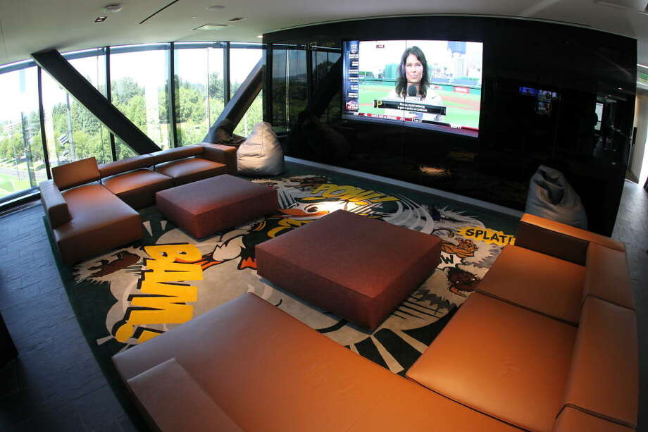 This lounge for Oregon players features eight 55-inch TV screens, six video-gaming stations and hand-woven, Ducks-themed  rugs inspired by comic-book art.  Photo: Eric Evans, GoDucks.com