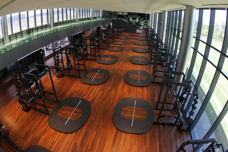 In the weight room, each squat rack has a custom Oregon ''O'' lifting mat. Oh, and on the mezzanine -- yes, there's a mezzanine (seen in the upper-left corner) -- there's a 40-yard electronic track lane, the school said.  Photo: Eric Evans, GoDucks.com