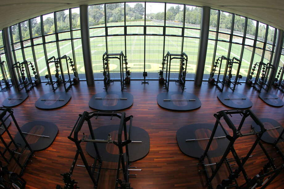 Oregon said the floor and wooden sections of the squat racks are made of Brazilian hardwood. Out the window are the practice fields.  Photo: Eric Evans, GoDucks.com