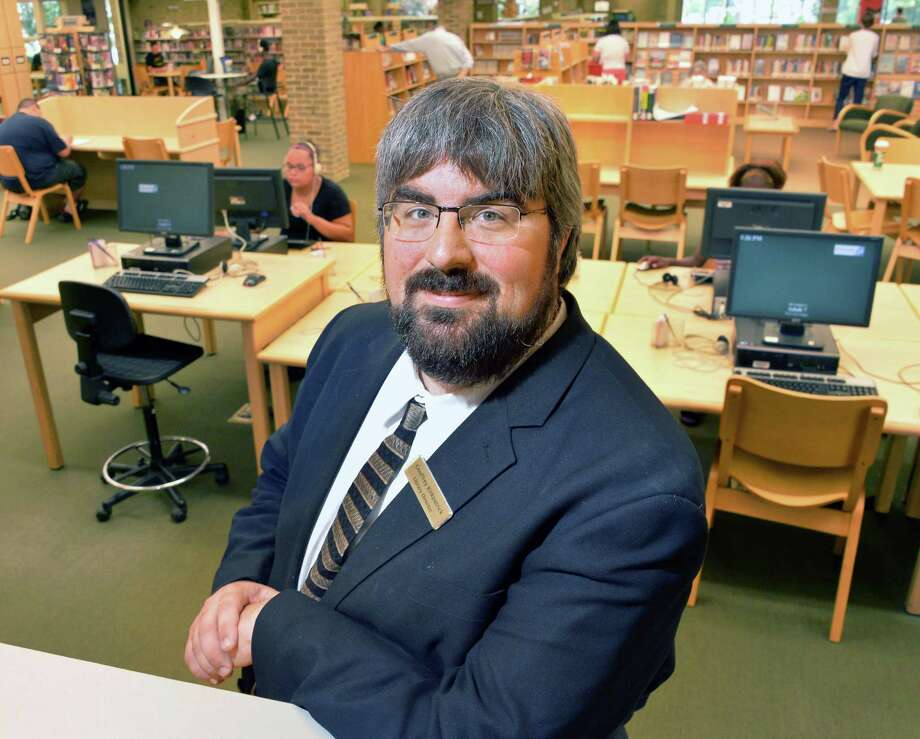 Bethlehem Public Library director Geoff Kirkpatrick Thursday Aug. 1, 2013, at the Library in Delmar, N.Y. Kirkpatrick was recently elected as New York Library Association president-elect and future president.  (John Carl D'Annibale / Times Union) Photo: John Carl D'Annibale / 10023371A