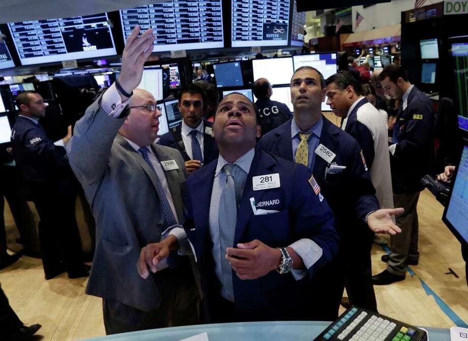 Top 10 percent earns more than: $159,276Bottom 10 percent earns less than: $30,948Source:Bloomberg Photo: Richard Drew, STF / AP