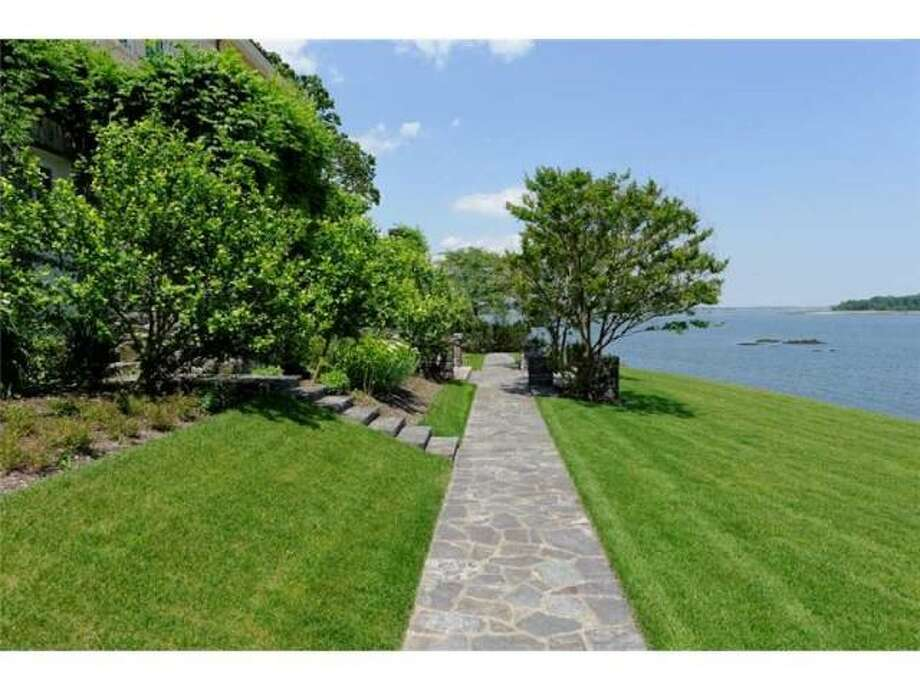 The 3.28 acre lot features a 100 foot stone terrace, as well as 440 feet of shoreline, which includes a sandy beach, stone pier and deepwater mooring, according to Coldwell Banker. Photo: Via Trulia.com
