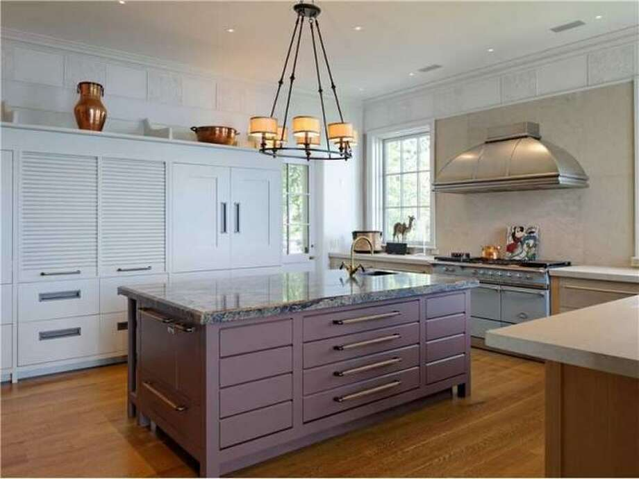 According to Coldwell Banker, you can ind a gourmet kitchen and a breakfast room in the 12,788 square foot home. Photo: Via Trulia.com