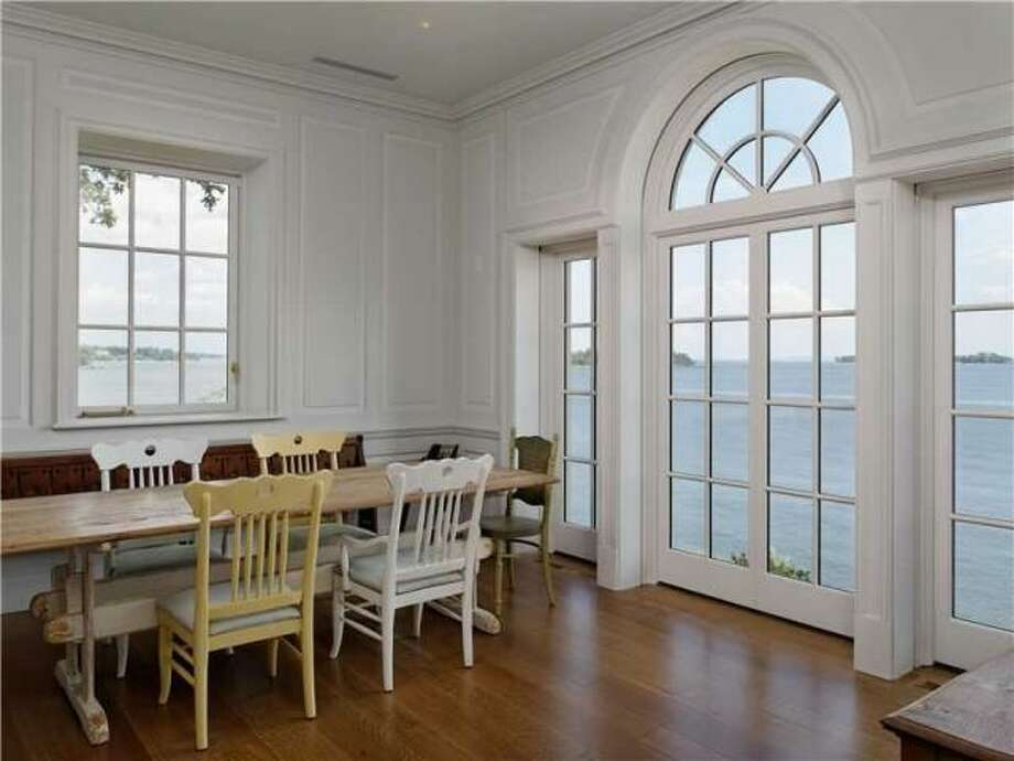 With 440 feet of shoreline on the 3.28 acre property, there's water views from many parts of the home. Photo: Via Trulia.com