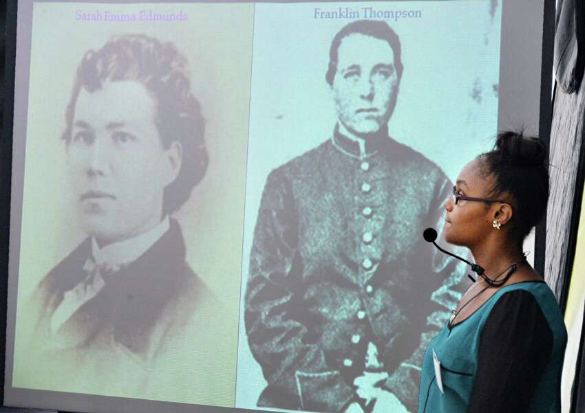 Asha Everett, 14, of Albany relates the story of Sara Emma Edmonson, who disguised herself as a man to fight in the Civil War, during the Underground Railroad summer project Thursday Aug. 1, 2013, at the Stephen and Harriet Myers Residence in Albany, N.Y. (John Carl D'Annibale / Times Union)