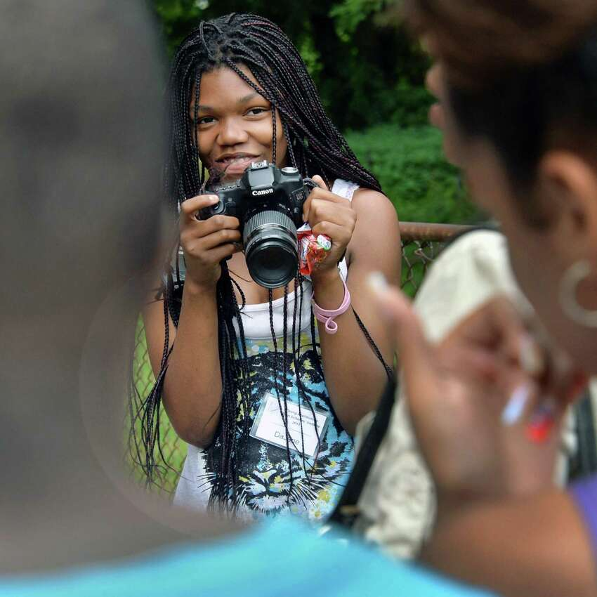 Photographer for the young abolitionists teen scholar's institute, DaJane Dozier, 14, of Albany, takes pictures of the group during the Underground Railroad summer project at the Stephen and Harriet Myers Residence Thursday Aug. 1, 2013, in Albany, N.Y. (John Carl D'Annibale / Times Union)