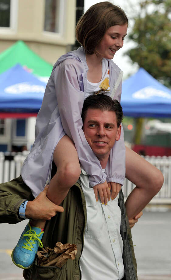 Jim Maxfield carries his daughter, Maddie, on his shoulders during the Alive@Five concert series at Columbus Park in Stamford on Thursday, Aug. 1, 2013. The Advocate newspaper is a sponsor of the event. Photo: Jason Rearick / Stamford Advocate