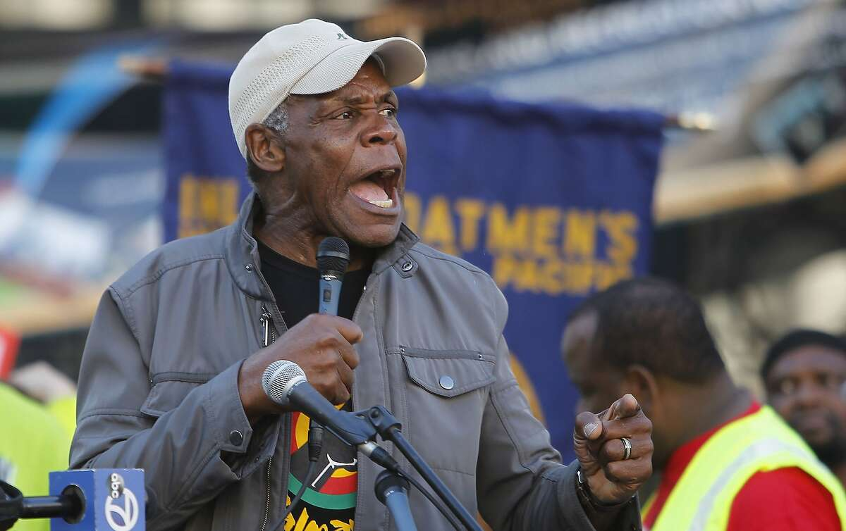 Actor and activist Danny Glover, seen here in 2013 speaking at a BART rally in Oakland, is in a new ad for Propositions F and I.