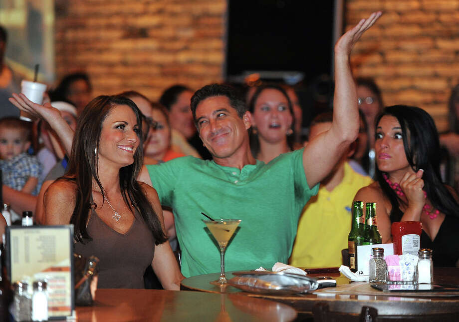 David Parkus smiles at Maddison's during a supportive applause shortly after being eliminated during the season finale of TNT's Hero Thursday night.  Photo taken Thursday, Aug 01, 2013 Guiseppe Barranco/The Enterprise Photo: Guiseppe Barranco, STAFF PHOTOGRAPHER / The Beaumont Enterprise
