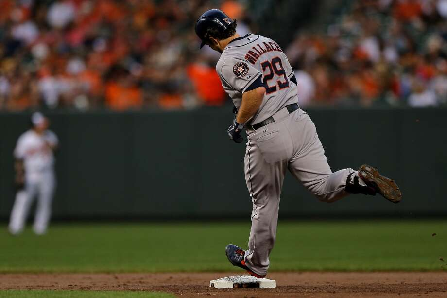 Brett Wallace of the Astros rounds the bases after hitting a home run in the second inning against the Orioles. Photo: Patrick Smith, Getty Images
