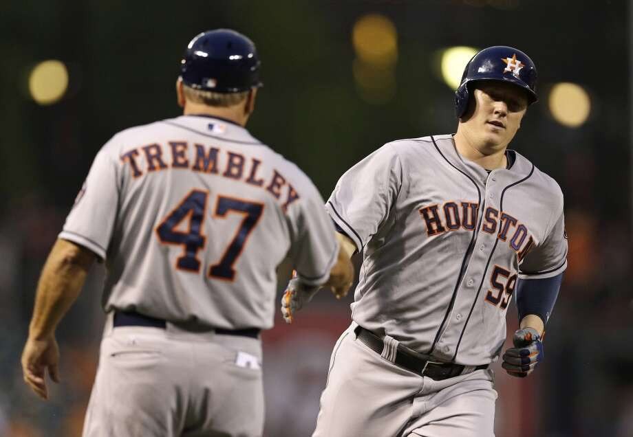 Marc Krauss of the Astros is congratulated by third base coach Dave Trembley after a home run. Photo: Patrick Semansky, Associated Press