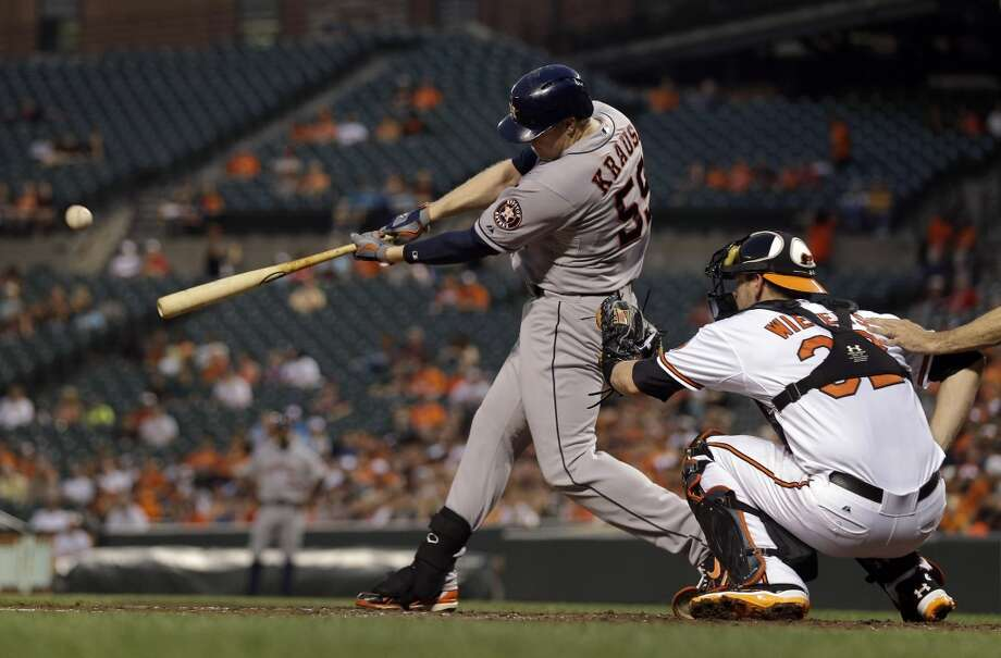 Marc Krauss of the Astros hits a home run against the Orioles. Photo: Patrick Semansky, Associated Press