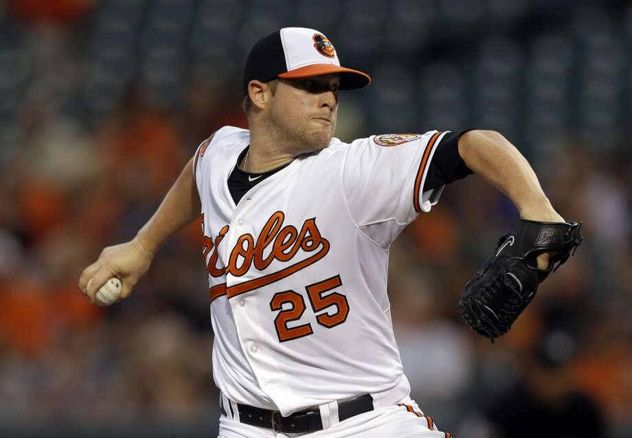 Orioles pitcher Bud Norris delivers a throw to the Astros. Photo: Patrick Semansky, Associated Press