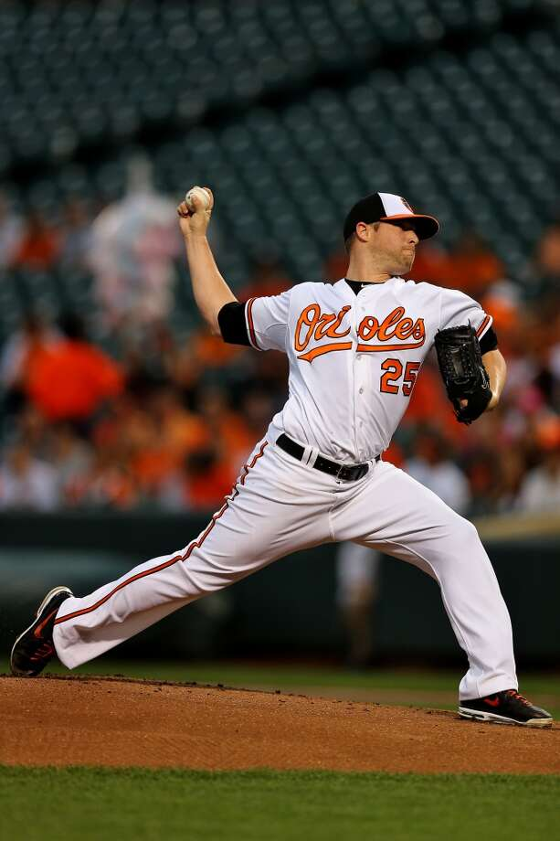 Orioles pitcher Bud Norris delivers a throw to the Astros. Photo: Patrick Smith, Getty Images