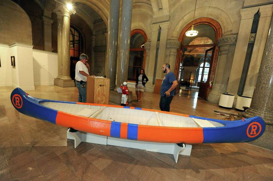 A Travers canoe is on display as part of a New York racing exhibit on the second floor of the Capitol on Thursday Aug. 1, 2013, in Albany, N.Y. (Michael P. Farrell/Times Union) Photo: Michael P. Farrell / 10023378A