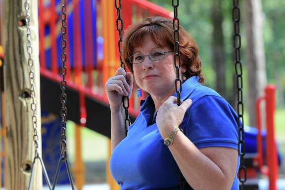 """Susan Lahmeyer, a former state child care licensing official, said the Jessica Tata case led her to retire. sits in a park, Thursday, Aug. 1, 2013, in Conroe. With a petition drive underway for a Harris County tax increase intended to improve quality at area daycares, Lahmeyer spoke to Lisa Falkenberg and described the horrific warehousing of children she witnessed over 22 years in the job: children neglected, dirty, bored and abused. She talks about the trauma of investigating the Tata case, and having to testify at the trial. Most of the kids she saw weren't in immediate danger, they were just being warehoused, just being kept alive and fed, without much stimulation. """"You could see it in their eyes,"""" she told me. """"You walk in there, and there's nothing going on. They're bored to death."""" ( Karen Warren / Houston Chronicle )"""