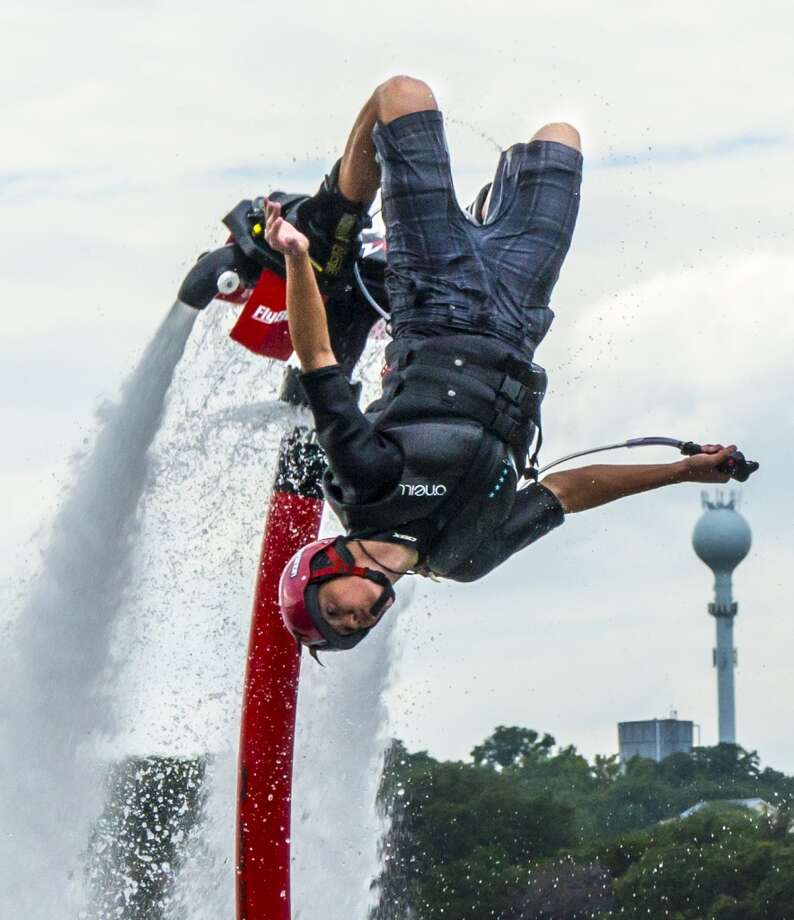 Damone Ripey of Aquafly Austin does a backflip on a flyboard on Lake Travis. (Joshua Trudell / For the San Antonio Express-News) Photo: Joshua Trudell, For The San Antonio Express-News