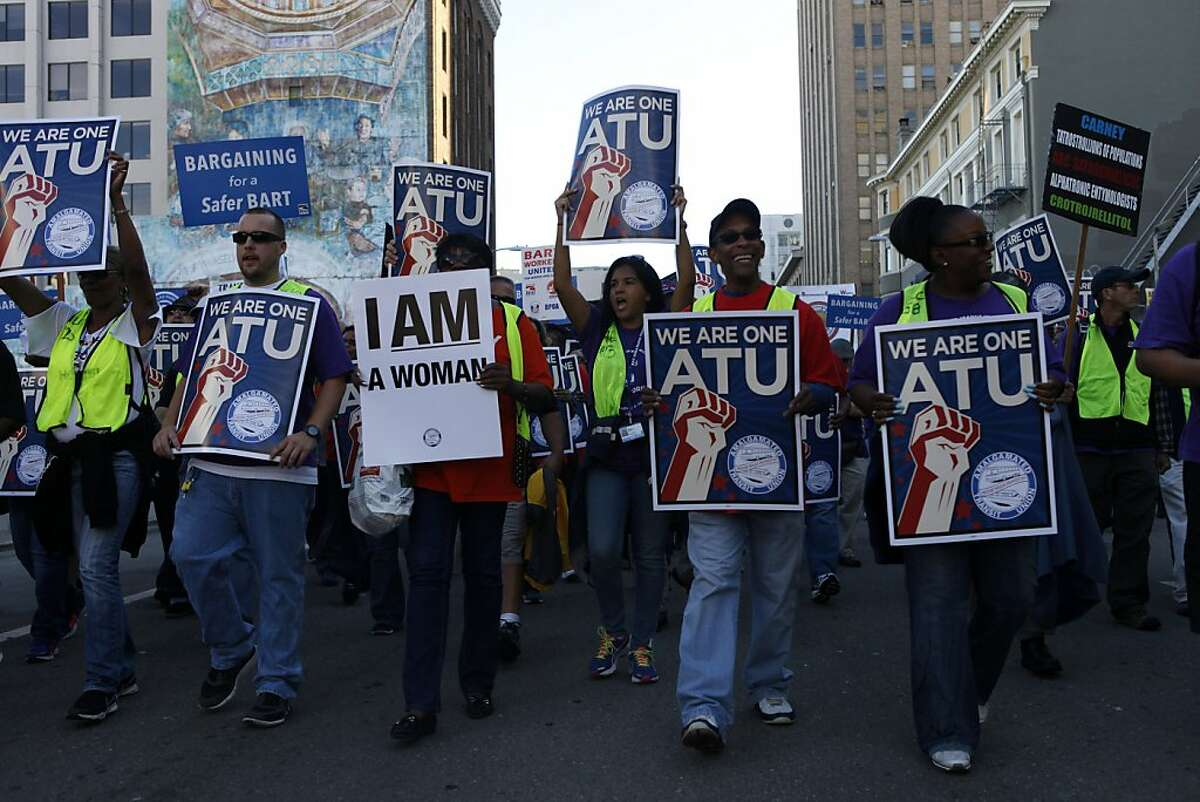 People rally in support of BART workers during a march to the BART headquarters on August 1, 2013 in Oakland, Calif.