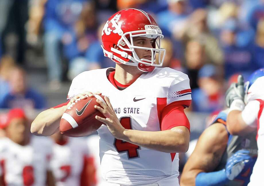 Fresno State's Derek Carr, the younger brother of former Texans QB David Carr, returns to lead one of the nation's most prolific passing offenses. Photo: Otto Kitsinger III, Getty Images / 2012 Getty Images
