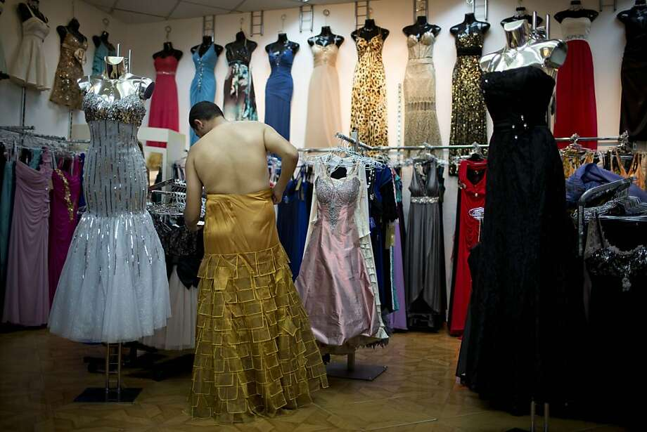 In this photo taken on Thursday, July 25, 2013, Israeli Orthodox Jew Shahar Hadar buys a woman's dress for his next drag queen show, in downtown Tel Aviv, Israel. Hadar, a telemarketer by day, has taken the gay Orthodox struggle from the synagogue to the stage, beginning to perform as one of Israel's few religious drag queens. His drag persona is that of a rebbetzin, a female rabbinic advisor, a wholesome guise that stands out among the sarcastic and raunchy cast of characters on Israel's drag queen circuit. (AP Photo/Oded Balilty) Photo: Oded Balilty, Associated Press