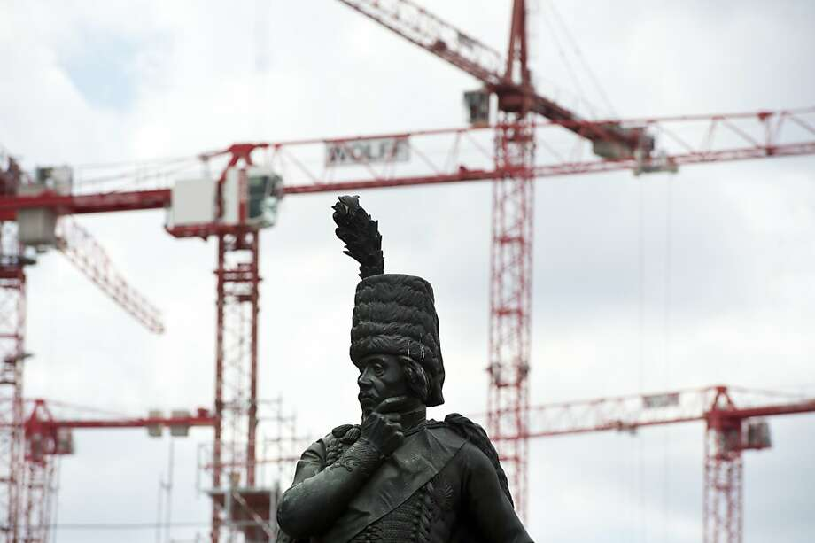 A statue of Prussian General Hans Joachim von Zieten stands in front of a construction site for a new shopping mall at Leipziger Platz in Berlin on August 1, 2013. AFP PHOTO / JOHN MACDOUGALLJOHN MACDOUGALL/AFP/Getty Images Photo: John Macdougall, AFP/Getty Images