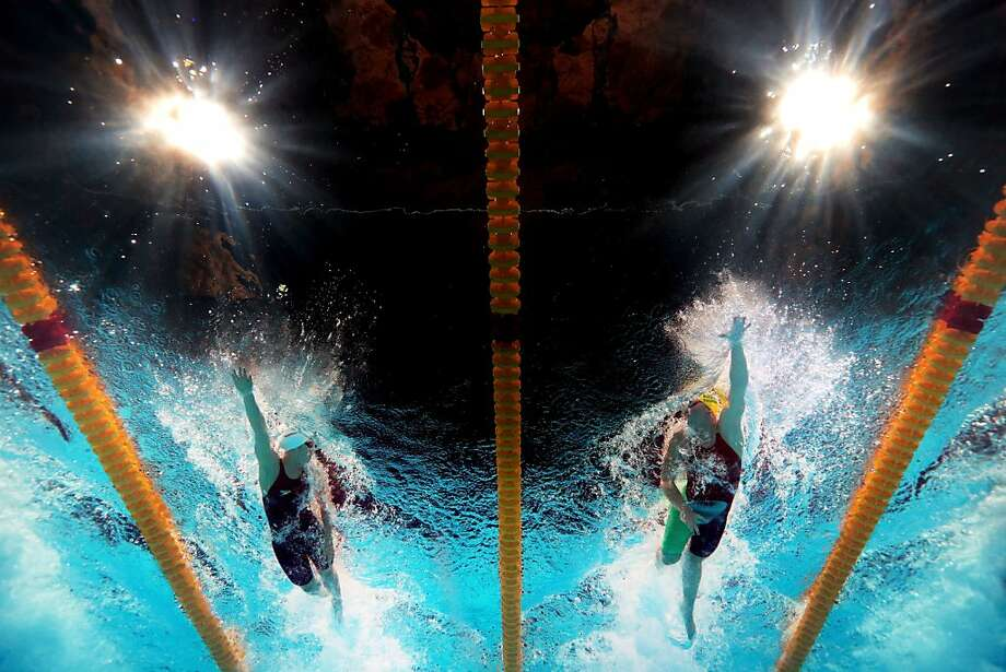 BARCELONA, SPAIN - AUGUST 01:  Shannon Vreeland (L) of the USA and Kylie Palmer of Australia compete during the Swimming Women's Freestyle 4x200m Final on day thirteen of the 15th FINA World Championships at Palau Sant Jordi on August 1, 2013 in Barcelona, Spain.  (Photo by Quinn Rooney/Getty Images) Photo: Quinn Rooney, Getty Images