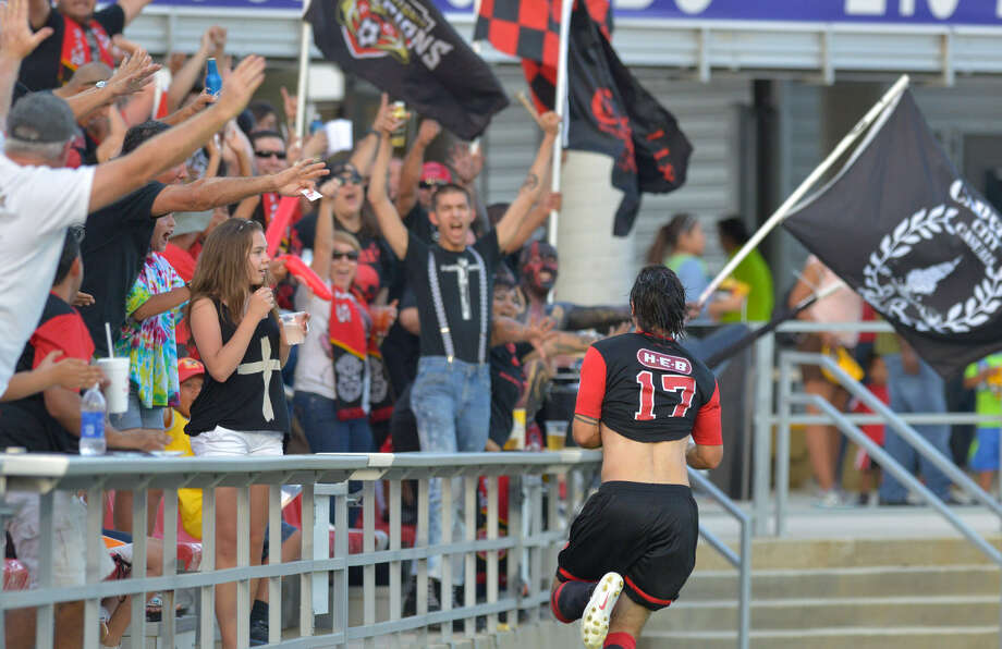 Members of the Casuals supporter group cheer Blake Wagner during a match at Toyota Field. The Scorpions want to expand their fan base. Photo: Robin Jerstad / For The Express-News